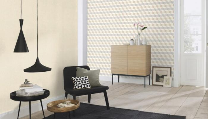 Tapeta z geometrycznym wzorem połączona z gładką ścianą i nowoczesnym wnętrzem pokoju gościnnego